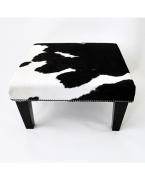 Cowhide Footstool 212, black and white with black tapered leg and studs